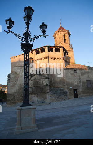 Sunrise in square on May 1, with side front and source of the church of San pablo and lamppost, Ubeda, Jaen province, - Stock Photo