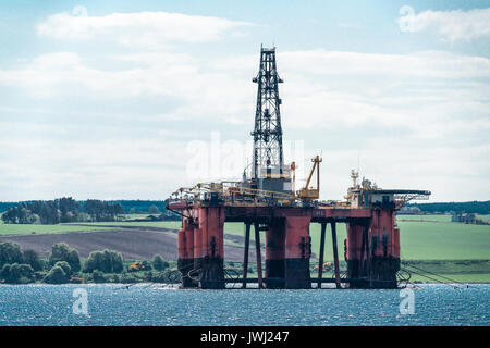 Disused North Sea oil drilling rig moored in the Cromarty Firth, Scotland - Stock Photo