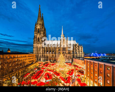 Christmas market in front of the Cathedral of Cologne, Germany - Stock Photo