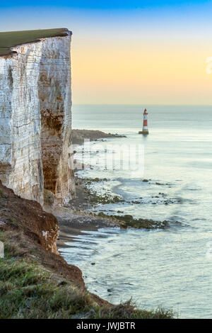 Beachy Head Light House and Chalk Cliffs at Sunrise, Sussex, England, UK - Stock Photo