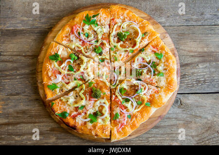 Vegetarian Pizza on rustic wooden background. Italian Pizza with Vegetables and Cheese close up. - Stock Photo