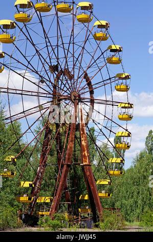 Ferris wheel in Pripyat ghost town in Chornobyl Exclusion Zone, Ukraine - Stock Photo