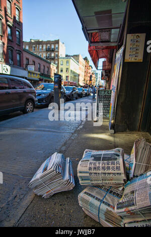 Newspapers on street - Stock Photo