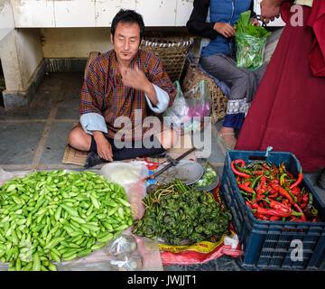 Thimphu, Bhutan - Aug 29, 2015. People at rural market in Thimphu, Bhutan. Bhutan is geopolitically in South Asia - Stock Photo