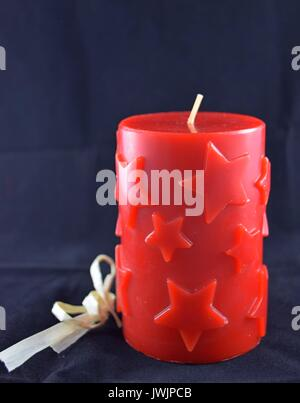 christmas candle with star pattern, tempus ante natale domini, Weihnachtskerze - Stock Photo