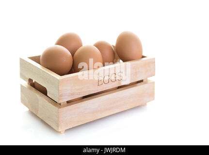 Wooden Egg Box on a white background - Stock Photo