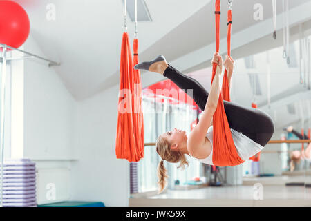young woman practices aerial anti gravity yoga with hammock     stock fly yoga  young woman practices aerial anti gravity yoga with      rh   alamy