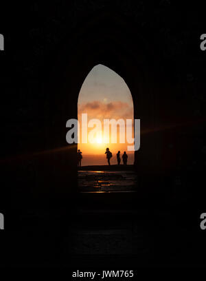 Sunrise view from Glastonbury Tor arch on the hill in Glastonbury, Great Britain - Stock Photo