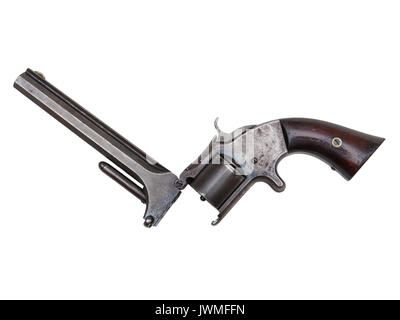An antique revolver isolated on white - Stock Photo