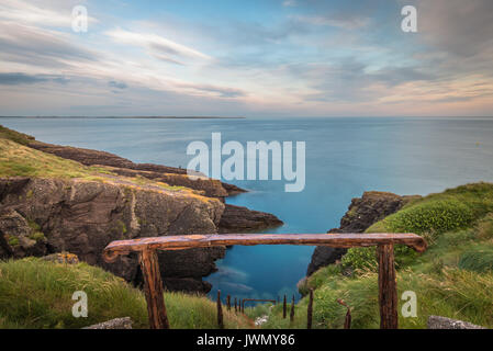 Railing by Cliffs at Dunmore East Ireland - Stock Photo