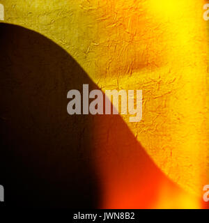 Blurred background yellow fabric and curved shadow. - Stock Photo