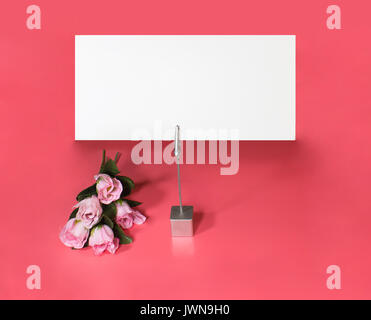 note holder with roses and empty card - Stock Photo