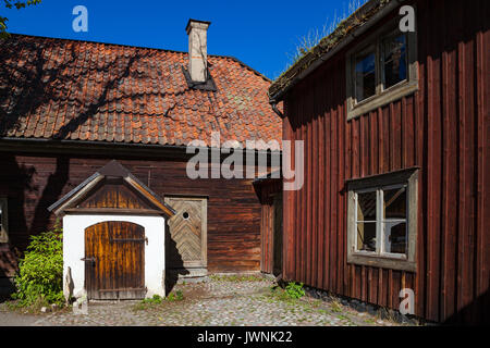 Traditional red wooden dwelling and farm in Skansen museum. Sweden - Stock Photo