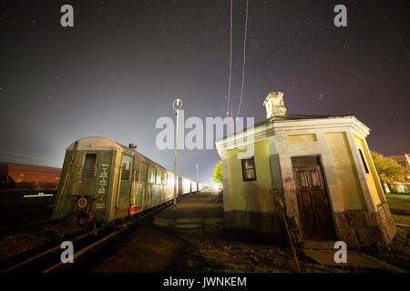 GULBENE, LATVIA - OCTOBER 20, 2016: Old trains at railway station. Night illuminated shot. - Stock Photo