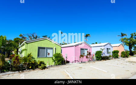 Row of pastel coloured cabins, Horseshoe Bay, Bowen, Queensland, QLD, Australia - Stock Photo