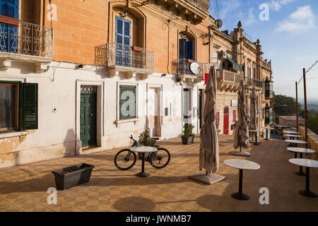 MDINA, MALTA - AUGUST, 30, 2016: Narrow street with cafe in the town - Stock Photo