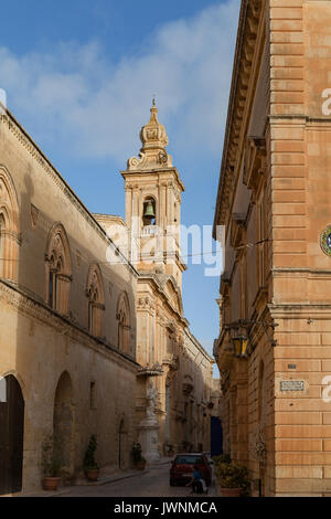 MDINA, MALTA - AUGUST, 30, 2016: Narrow street with church in the old town - Stock Photo