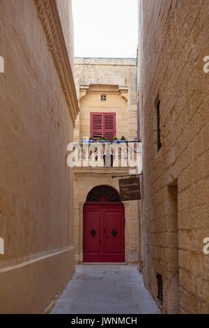 MDINA, MALTA - AUGUST, 30, 2016: Narrow medieval street in old town - Stock Photo