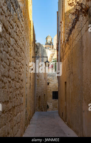 Streets of old town at sunny day. Narrow path in Mdina, Malta. - Stock Photo
