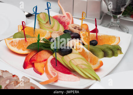 Refreshing selection of summer fruits - Stock Photo