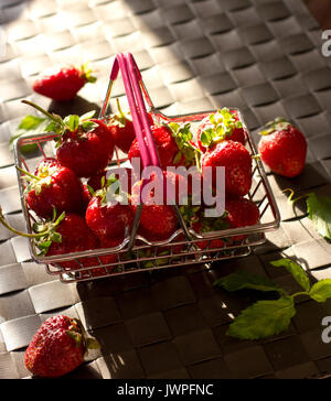 Strawberry and mint in a shopping basket - Stock Photo