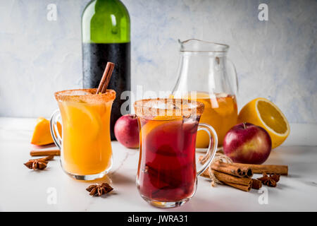 Traditional fall and winter drinks and cocktails. White and red autumn hot spicy sangria with anise, cinnamon, apple, - Stock Photo