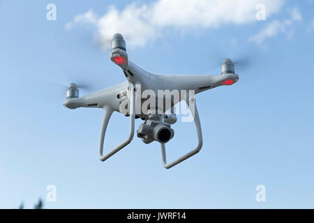 Phantom 4 pro drone in flight - Stock Photo
