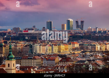 View of Old Town with colorful houses and red roofs and modern buildings on background in Prague, Czech Republic. - Stock Photo