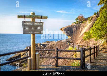 Kumano, Japan coast line at Onigajo 'Devil's Castle' rocks on the coastline. (Sign reads: 'Yoshino-Kumano National - Stock Photo