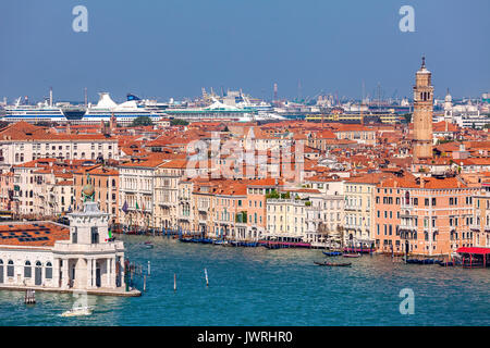 View of Grand canal and old houses with red roofs in Venice, Italy. - Stock Photo