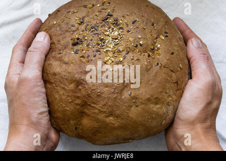 Holding the homemade bread - Stock Photo