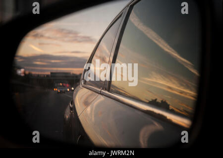 Sunset on the M40 driving in to London - Stock Photo