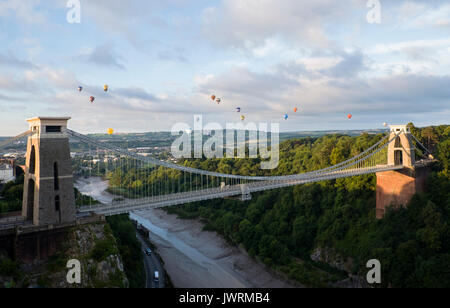 Hot air balloons flying over the Avon Gorge and the Clifton Suspension Bridge, Bristol, UK. - Stock Photo