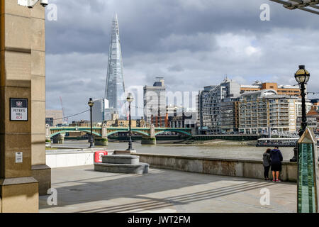 London, United Kingdom - August 3, 2017: View accross the River Thames looking towards the Shard.  Taken from under - Stock Photo