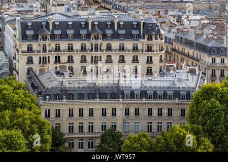 Haussmannian building facades and mansard rooftops in summer. 16th Arrondissement of Paris. France - Stock Photo