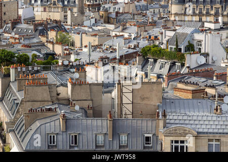 Paris rooftops in summer with roof gardens and mansard roofs. 17th Arrondissement of Paris, France - Stock Photo