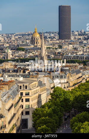 Paris rooftops in summer with view on the Invalides and Montparnasse Tower. Paris, France - Stock Photo