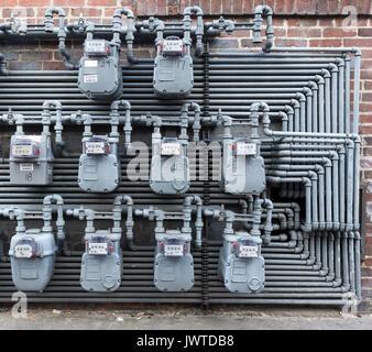 Savannah, Georgia, USA - 27 November 2010: Array of gas meters on apartment house wall - Stock Photo