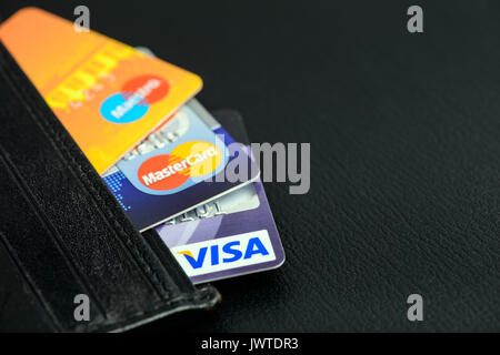 Moscowi, Russia - August 05, 2017: Visa and Mastercard credit cards in leather wallet - Stock Photo