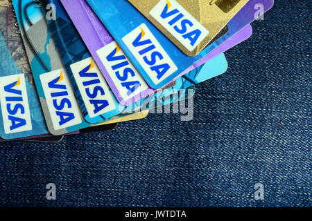 Moscowi, Russia - August 05, 2017: Visa credit cards over blue jeans - Stock Photo