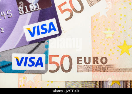 Moscowi, Russia - August 05, 2017: Visa credit cards over Euro currency banknotes - Stock Photo