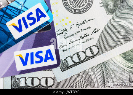 Moscowi, Russia - August 05, 2017: Visa credit cards over USA dollar currency banknotes - Stock Photo