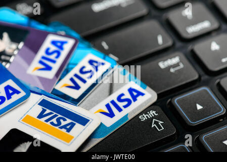 Moscowi, Russia - August 05, 2017: Visa credit cards onr notebook keyboard - Stock Photo