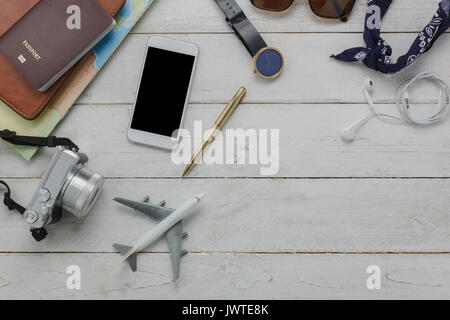 Top view of essential accessories to travel and transportation concept.Items 's traveler and teen for holidays or - Stock Photo