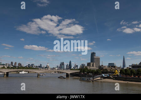 River Thames, Embankment,London, UK. 13 August 2017. UK Weather: Warm sunny day with light cloud over London skyline. - Stock Photo