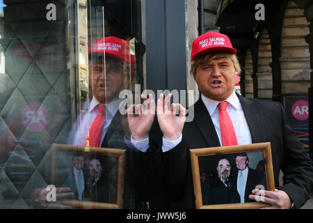 Edinburgh, Scotland, UK. 13th Aug, 2017. 'Donald Trump' (Danny Posthill an Impressionist) waits outside the Assembly - Stock Photo
