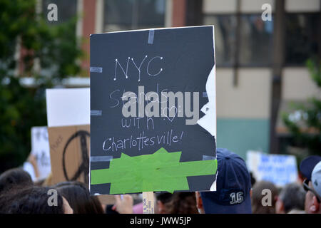 Charlottesville, USA. 13th Aug, 2017. People gathered in Union Square to denounce President Trump and the neo-nazi - Stock Photo