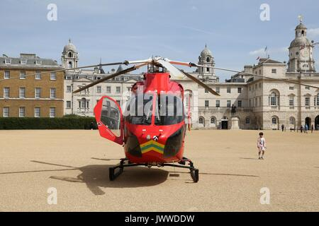 Westminster. London, UK. 14th Aug, 2017. An air ambulance in Horse Guard Parade in Whitehall, attending an emergency - Stock Photo