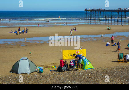 Summer holiday crowds on the beach, Saltburn by the Sea, North Yorkshire - Stock Photo
