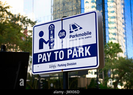 Pay to Park sign for street parking on E Jackson Street in downtown Tampa FL, USA - Stock Photo